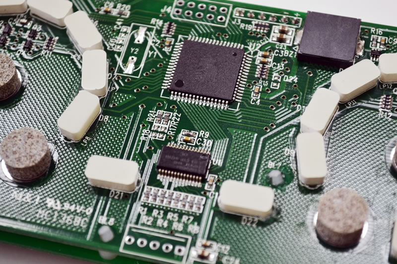PCB assembly for capacitive appliance controller.