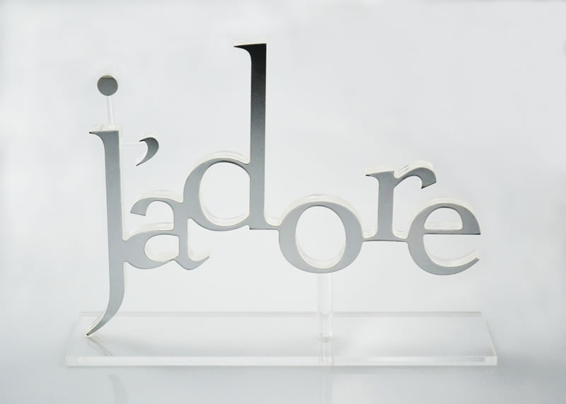 Precise laser cutting with chrome look letters and clear acrylic.