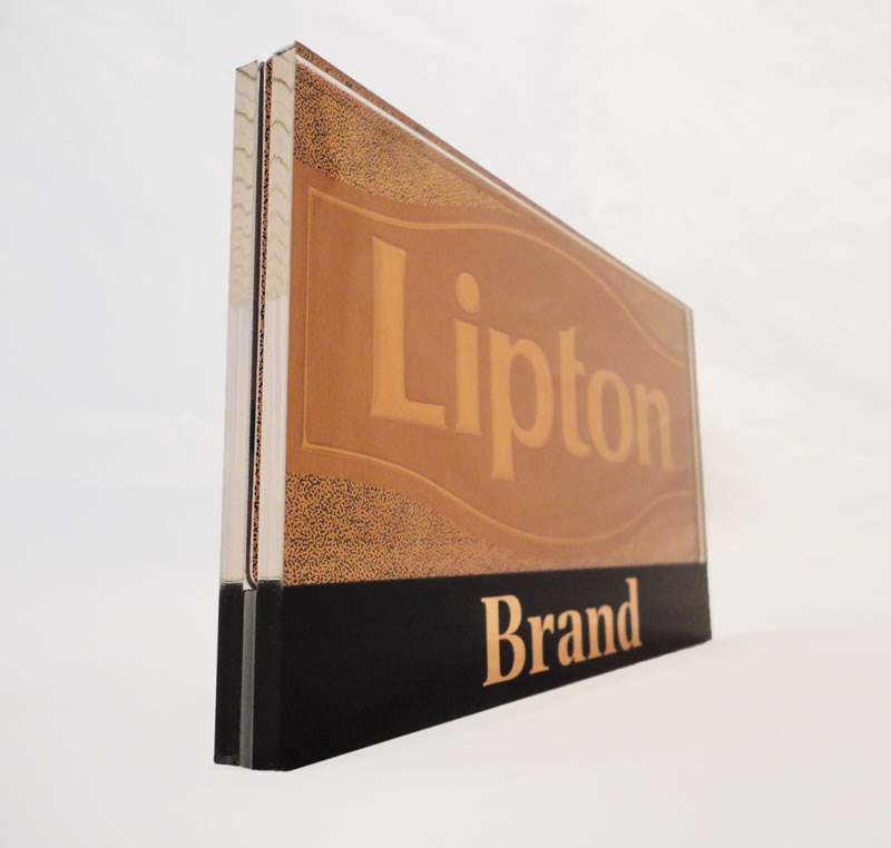 Two-sided replaceable embossed metal insert in custom printed acrylic holder.