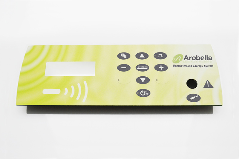 Membrane switch assembly with digital printed overlay and embossed keys.