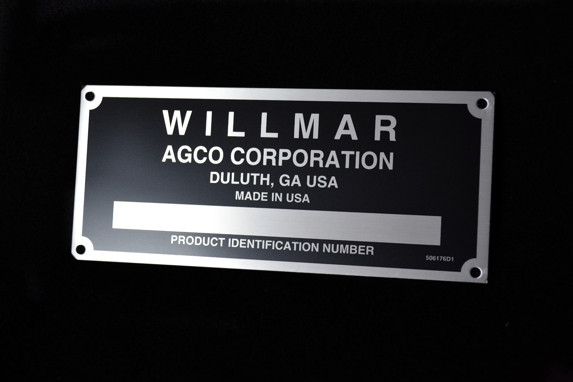 Metal nameplate printed using lithography and screen printing.